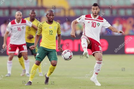 South Africa's Kamohelo Mokotjo (L) in action against Morocco's Younes Belhanda (R) during the 2019 Africa Cup of Nations (AFCON) group D soccer match between South Africa and Morocco at  Al-Salam Stadium in Cairo, Egypt, 01 July 2019.