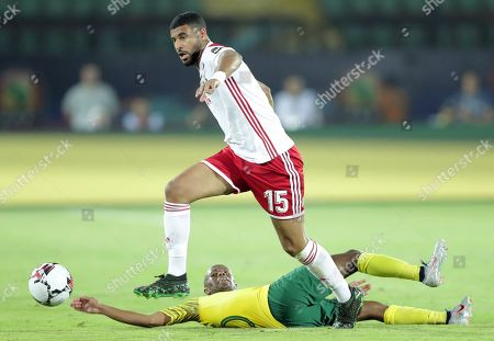 Stock Picture of South Africa's Thulani Serero (down) in action against Morocco's Youssef Ait Bennasser during the 2019 Africa Cup of Nations (AFCON) group D soccer match between South Africa and Morocco at  Al-Salam Stadium in Cairo, Egypt, 01 July 2019.