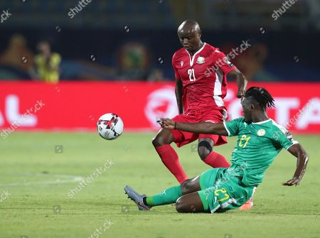 Senegal's Lamine Gassama, right, duels for the ball with Kenya's Dennis Odhiambo during the African Cup of Nations group D soccer match between Kenya and Senegal Stadium in Cairo, Egypt