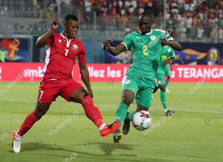 Kenya's Masika Ayb Timbe, left, duels for the ball with Senegal's Saliou Ciss during the African Cup of Nations group D soccer match between Kenya and Senegal in 30 June Stadium in Cairo, Egypt