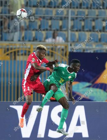 Senegal's Ismaila Sarr, right, duels for the ball with Kenya's Abud Omar Khamis Abud during the African Cup of Nations group D soccer match between Kenya and Senegal in 30 June Stadium in Cairo, Egypt