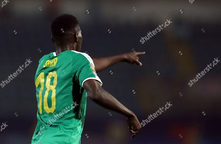 Senegal's Ismaila Sarr celebrates after scoring his side's opening goal during the African Cup of Nations group D soccer match between Kenya and Senegal in 30 June Stadium in Cairo, Egypt