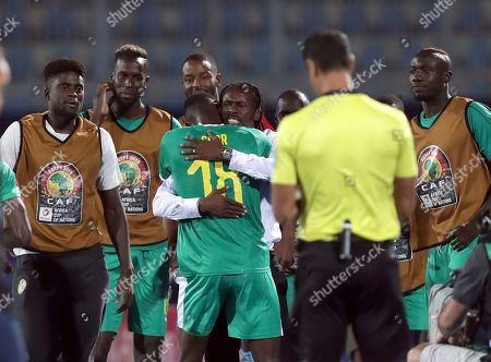 Senegal's Ismaila Sarr, center, celebrates with coach Allow Cisse after scoring his side's opening goal during the African Cup of Nations group D soccer match between Kenya and Senegal in 30 June Stadium in Cairo, Egypt