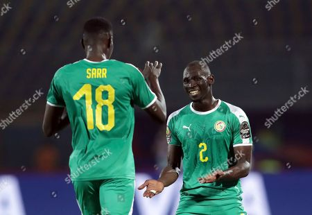 Senegal's Ismaila Sarr, left, celebrates with Senegal's Saliou Ciss after scoring his side's opening goal during the African Cup of Nations group D soccer match between Kenya and Senegal in 30 June Stadium in Cairo, Egypt