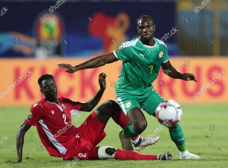 Stock Photo of Senegal's Moussa Konate, right, duels for the ball with Kenya's Joseph Okumu during the African Cup of Nations group D soccer match between Kenya and Senegal in 30 June Stadium in Cairo, Egypt