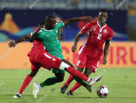 Stock Image of Senegal's Moussa Konate, center, duels for the ball with Kenya's Joseph Okumu, left, and Kenya's Victor Wanyama during the African Cup of Nations group D soccer match between Kenya and Senegal in 30 June Stadium in Cairo, Egypt