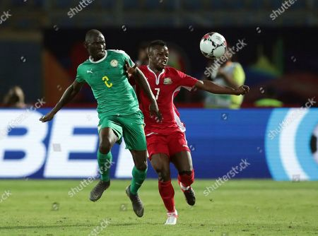 Senegal's Saliou Ciss, left, duels for the ball with Kenya's Masika Ayb Timbe during the African Cup of Nations group D soccer match between Kenya and Senegal in 30 June Stadium in Cairo, Egypt