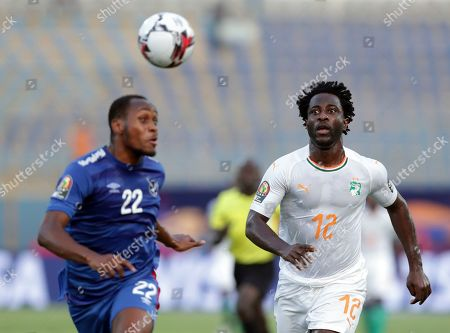 Stock Image of Ivory Coast's Wilfried Bony, right, and Namibia's Rayan Nyambe run for the ball during the African Cup of Nations group D soccer match between Namibia and Ivory Coast Stadium in Cairo, Egypt