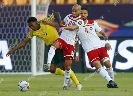 South Africa's Lebo Mothiba, left, and Morocco's Karim El Ahmadi Aroussi fight for the ball during the African Cup of Nations group D soccer match between South Africa and Morocco in Al Salam Stadium in Cairo, Egypt