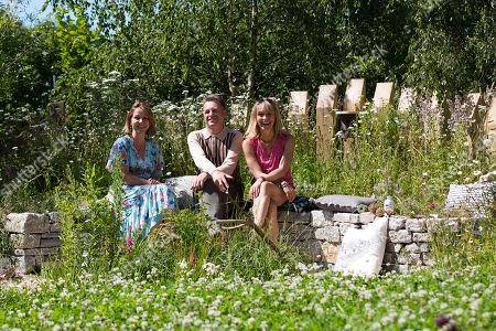 British conservationist, Chris Packham (centre) with garden designer, Jo Thompson (L) and Television presenter, Michaela Strachan (R) pose in the BBC Springwatch garden during the press day of the RHS Hampton Court Palace Garden Festival in London, Britain, 01 July 2019. The RHS Hampton Court Palace Garden Festival is a garden show held for five days by the Royal Horticultural Society in the grounds of Hampton Court Palace and runs this year from 02 July to 07 July.