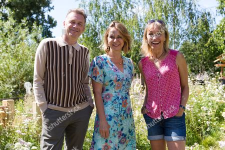 British conservationist, Chris Packham (left) with garden designer, Jo Thompson (centre) and Television presenter, Michaela Strachan (right) pose in the BBC Springwatch garden during the press day of the RHS Hampton Court Palace Garden Festival in London, Britain, 01 July 2019. The RHS Hampton Court Palace Garden Festival is a garden show held for five days by the Royal Horticultural Society in the grounds of Hampton Court Palace and runs this year from 02 July to 07 July.