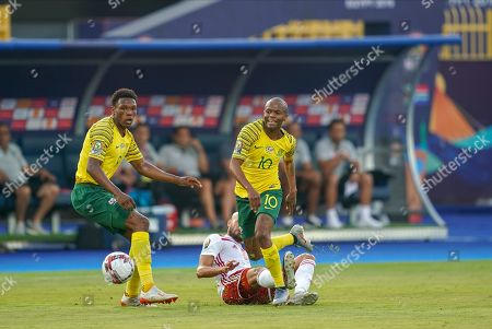 Karim El Ahmadi Aroussi of Morocco fouling Thulani Caleb Serero of South Africa during the African Cup of Nations match between South Africa and Morocco at the Al Salam Stadium in Cairo, Egypt