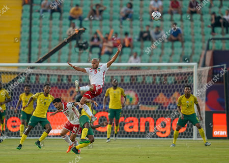 Percy Muzi Tau of South Africa fouling Karim El Ahmadi Aroussi of Morocco during the African Cup of Nations match between South Africa and Morocco at the Al Salam Stadium in Cairo, Egypt