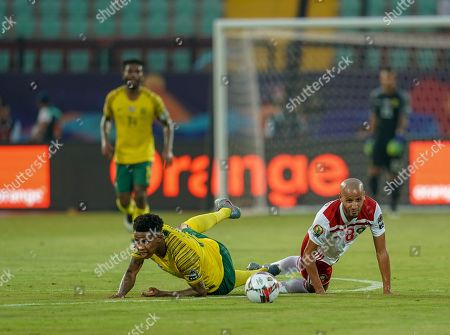 Stock Image of Bongani Zungu of South Africa and Karim El Ahmadi Aroussi of Morocco challenging for the ball during the African Cup of Nations match between South Africa and Morocco at the Al Salam Stadium in Cairo, Egypt