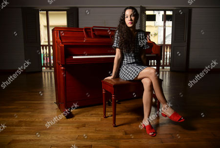"""Puerto Rican singer Ileana Cabra, also known has Ileana Cabra, poses for a portrait inside the Ruth Fernandez Cultural House in San Juan, Puerto Rico. Ileana Cabra sings against hate and machismo in her latest album """"Almadura."""" The album also includes two romantic songs featuring pianist Eddie Palmieri"""