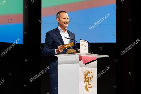 David Gardner, Vice President for Games at BAFTA, announces the winner of the Mentor award