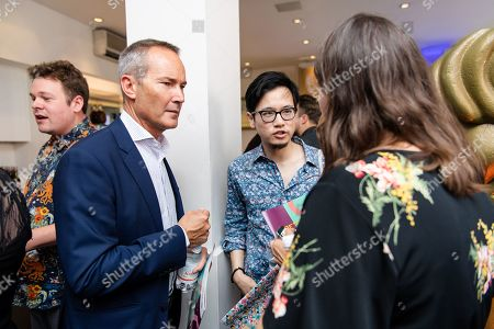 Stock Image of Presenter David Gardner talking to guests