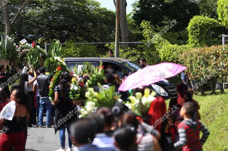 A view of the funeral car of Oscar Martinez and his daughter Valeria during their funeral, in San Salvador, El Salvador, 01 July 2019. The bodies of Salvadorans Oscar Martinez and his daughter Valeria, who drowned past 23 June at the Rio Bravo while attempting to reach US territory, were buried in San Salvador today in a private ceremony.