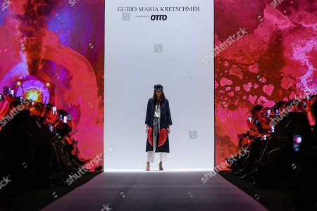 A model presents a creation by designer Guido Maria Kretschmer during the Mercedes-Benz Fashion Week in Berlin, Germany, 01 July 2019. The Spring/Summer 2020 collections are presented at the MBFW Berlin from 01 to 03 July.