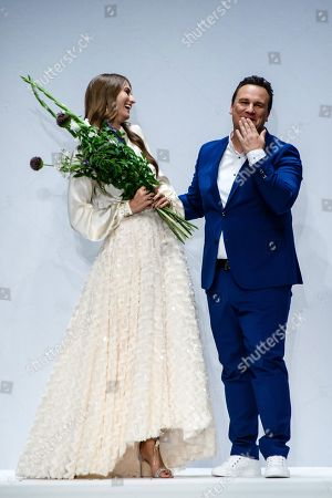 Designer Guido Maria Kretschmer (R) receives flowers during his show at the Mercedes-Benz Fashion Week in Berlin, Germany, 01 July 2019. The Spring/Summer 2020 collections are presented at the MBFW Berlin from 01 to 03 July.
