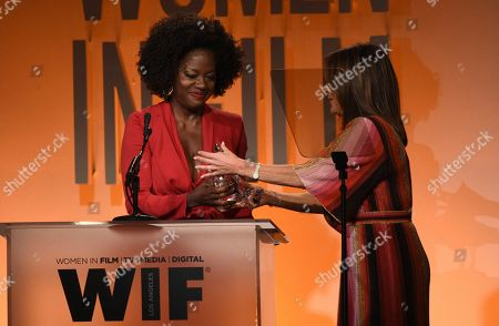 Viola Davis, Cathy Schulman. Viola Davis, left, presents the crystal award for advocacy in entertainment to Cathy Schulman at the Women in Film Annual Gala, at the Beverly Hilton Hotel in Beverly Hills, Calif