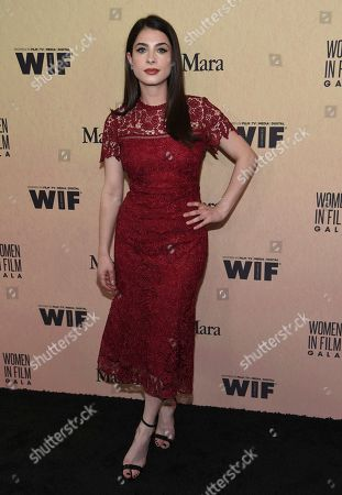 Niki Koss arrives at the Women in Film Annual Gala, at the Beverly Hilton Hotel in Beverly Hills, Calif