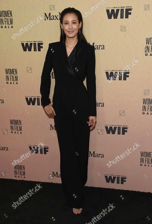 Stock Image of Claudia Kim arrives at the Women in Film Annual Gala, at the Beverly Hilton Hotel in Beverly Hills, Calif