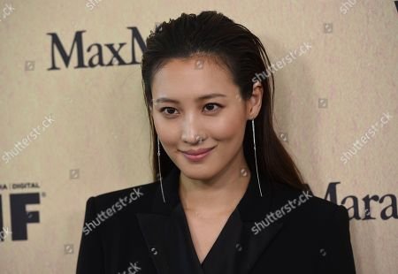 Claudia Kim arrives at the Women in Film Annual Gala, at the Beverly Hilton Hotel in Beverly Hills, Calif