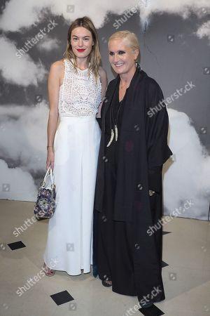Camille Rowe and Dior designer Maria Grazia Chiuri in the front row