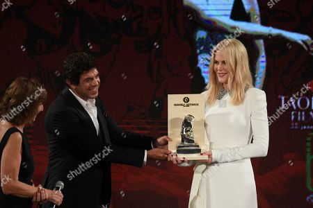 Stock Picture of Nicole Kidman receives the 'Taormina Art Award' from Pierfrancesco Favino during a ceremony at the Teatro Antico