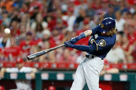 Milwaukee Brewers' Ben Gamel (16) hits an RBI double off Cincinnati Reds relief pitcher David Hernandez during the seventh inning of a baseball game, in Cincinnati