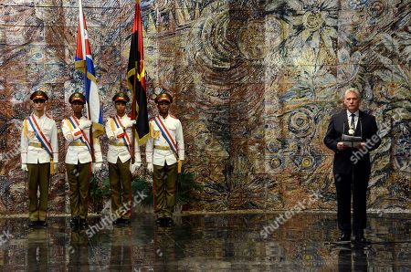 Cuba's President Miguel Diaz-Canel speaks during a ceremony with Angola's President Joao Manuel Goncalves Lourenco, not seen, at the Revolution Palace in Havana, Cuba, . Goncalves is on two-day official visit to Cuba