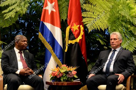 Angola's President Joao Manuel Goncalves Lourenco, left, talks with Cuba's President Miguel Diaz-Canel at the Revolution Palace in Havana, Cuba, . Goncalves is on two-day official visit to Cuba