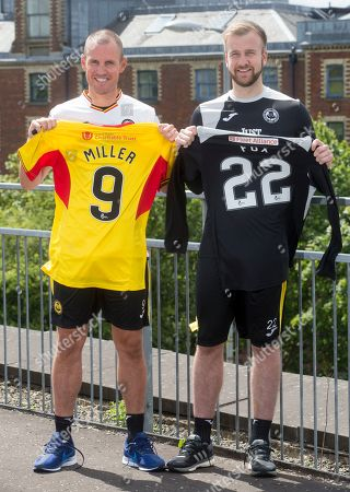 Former Scotland player Kenny Miller signs for Partick Thistle with Keeper Scott Fox (right)
