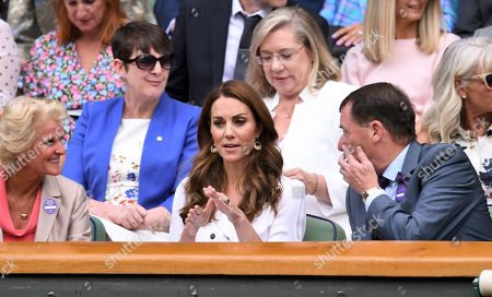 Catherine Duchess of Cambridge, Gill Brook (left) and Philip Brook in the Centre Court Royal Box