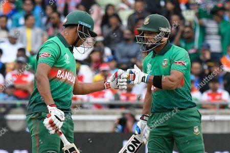 Mohammad Saifuddin of Bangladesh and Sabbir Rahman of Bangladesh touch gloves during the ICC Cricket World Cup 2019 match between Bangladesh and India at Edgbaston, Birmingham