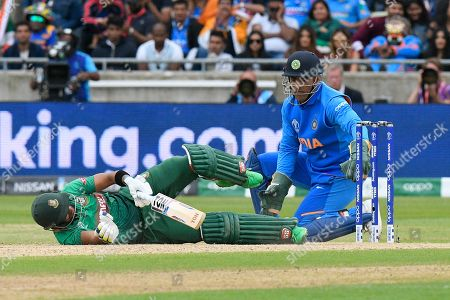 Sabbir Rahman of Bangladesh falls over during the ICC Cricket World Cup 2019 match between Bangladesh and India at Edgbaston, Birmingham
