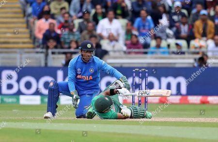 Bangladesh's Sabbir Rahman falls after playing a shot during the Cricket World Cup match between India and Bangladesh at Edgbaston in Birmingham, England