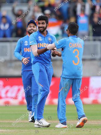 India's Jasprit Bumrah, left, celebrates after the dismissal of Bangladesh's Sabbir Rahman during the Cricket World Cup match between India and Bangladesh at Edgbaston in Birmingham, England