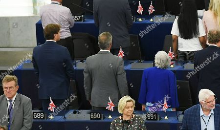 Stock Image of (Center row, L-R) Richard James Tice, Nigel Farage and Ann Widdecombe of the Brexit Party turn their backs on the musicians during the European Anthem at the first session of the new Parliament at the European Parliament, in Strasbourg, France, 02 July 2019.