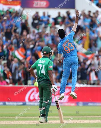 Stock Photo of India's Jasprit Bumrah, right, jumps to celebrate the dismissal of Bangladesh's Sabbir Rahman during the Cricket World Cup match between Bangladesh and India at Edgbaston in Birmingham, England