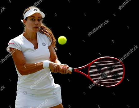 Stefanie Voegele of Switzerland in action against Kaia Kanepi of Estland during their first round match at the Wimbledon Championships at the All England Lawn Tennis Club, in London, Britain, 02 July 2019.