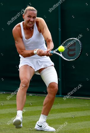 Kaia Kanepi of Estland in action against Stefanie Voegele of Switzerland during their first round match at the Wimbledon Championships at the All England Lawn Tennis Club, in London, Britain, 02 July 2019.