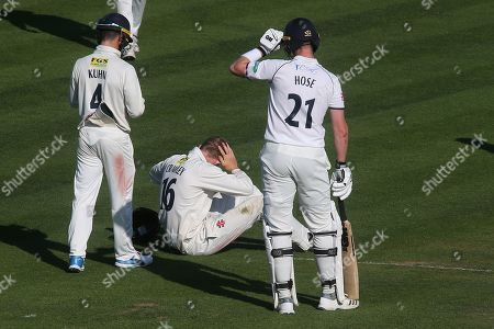 Kent's Zak Crawley rubs his head after being hit on his helmet by Warwickshire's Adam Hose during Kent CCC vs Warwickshire CCC, Specsavers County Championship Division 1 Cricket at the St Lawrence Ground on 2nd July 2019