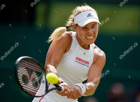 Angelique Kerber of Germany returns to compatriot Tatjana Maria in their first round match during the Wimbledon Championships at the All England Lawn Tennis Club, in London, Britain, 02 July 2019.