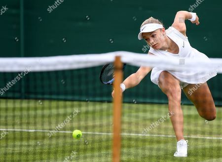 Katie Swan of Britain in action against Laura Siegemund of Germany during their first round match at the Wimbledon Championships at the All England Lawn Tennis Club, in London, Britain, 02 July 2019.