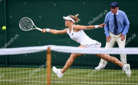 Laura Siegemund of Germany in action against Katie Swan of Britain during their first round match at the Wimbledon Championships at the All England Lawn Tennis Club, in London, Britain, 02 July 2019.