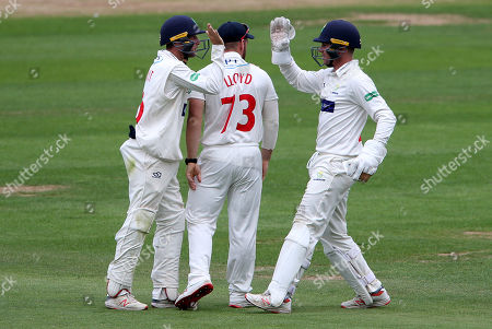 Billy Root and Tom Cullen of Glamorgan celebrate after running out Charlie Morris.