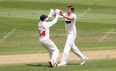 Michael Hogan of Glamorgan celebrates with Tom Cullen after bowling out Ed Barnard for LBW.