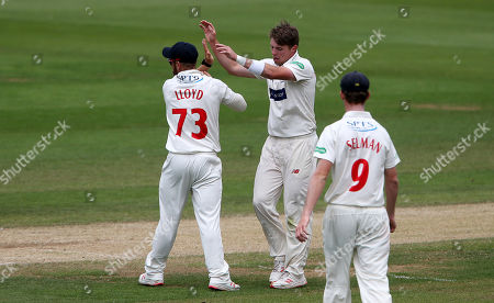 Dan Douthwaite of Glamorgan celebrates after Ben Cox is caught by Tom Cullen.